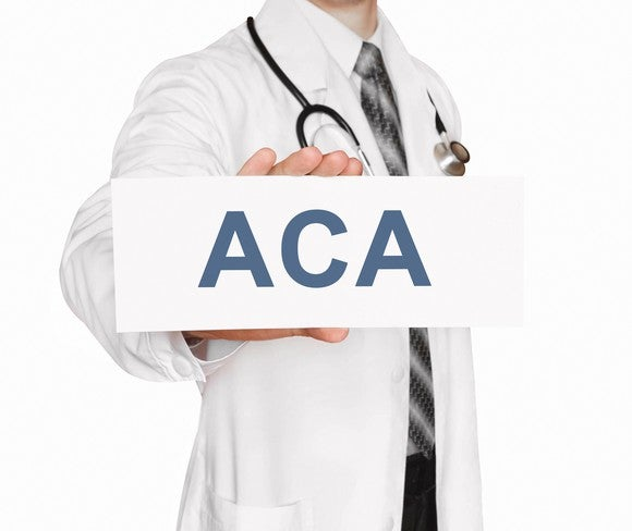 Doctor with ACA sign