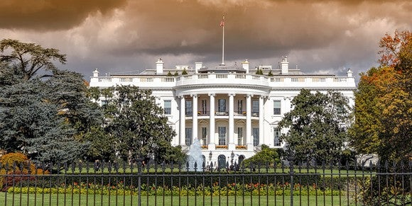 The White House under a cloudy sky.