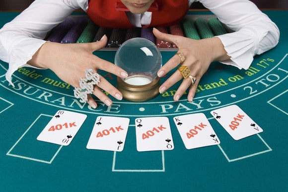 Fortune teller with crystal ball and playing cards labeled 401k.