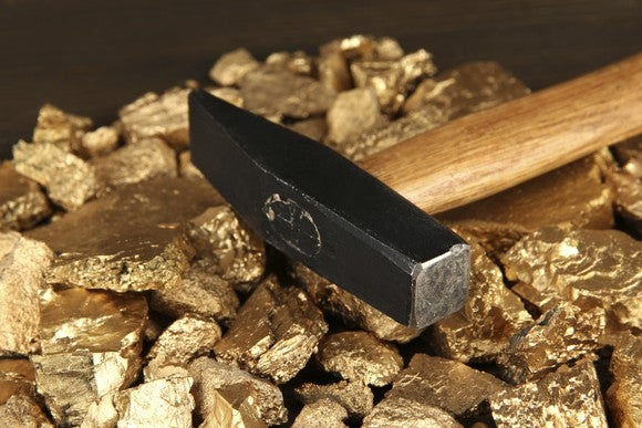 Gold Nuggets With Rock Hammer Getty