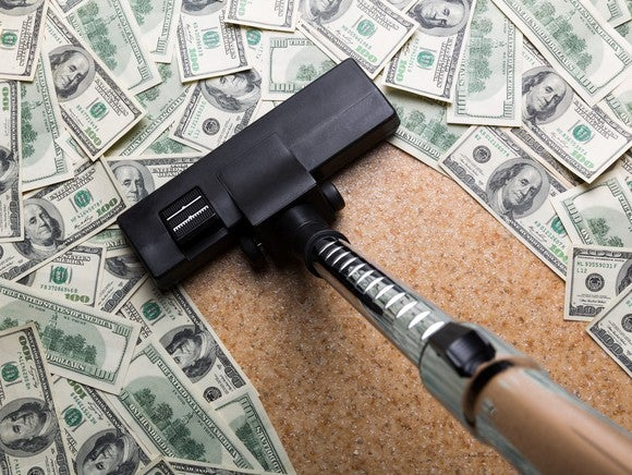 Vacuum Up Money On The Floor Getty