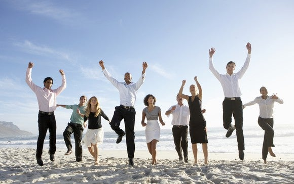 Businesspeople On Beach Cheering Getty