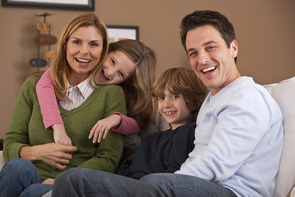 Smiling Family With Children On Couch Getty