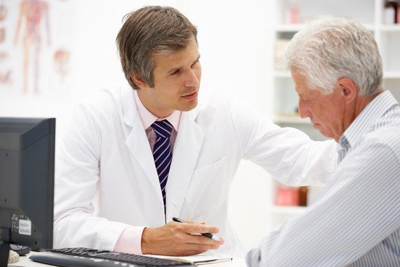 Doctor Consoling Patient Consultation Getty