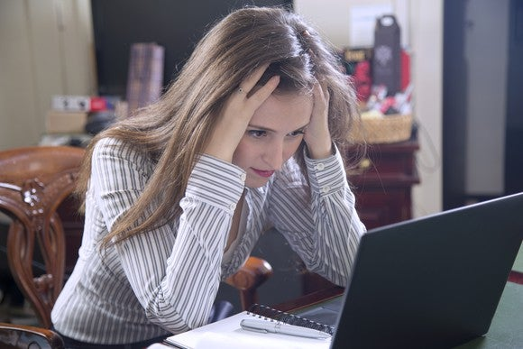 Stressed Woman On Laptop Checking Stocks Getty