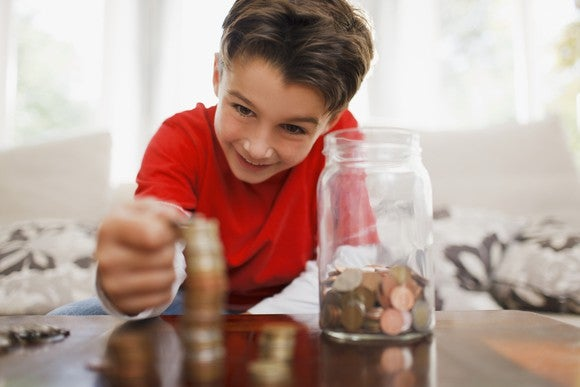 Boy Stacking Coins