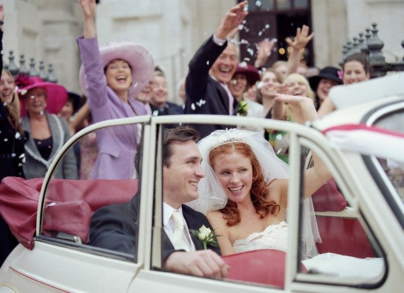 Bride And Groom Driving Off In Car