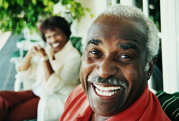 Elderly Retired Man Smiling With Woman Getty