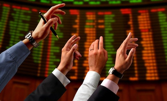 Stock Market Raising Hands Getty
