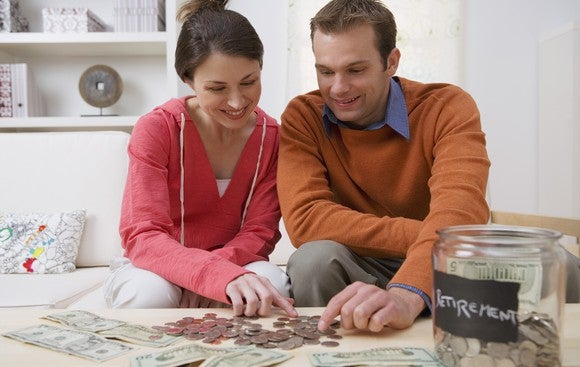 Couple Counting Coins Planning For Retirement Getty