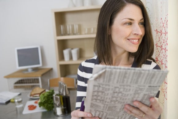 Woman With Financial Newspaper Getty