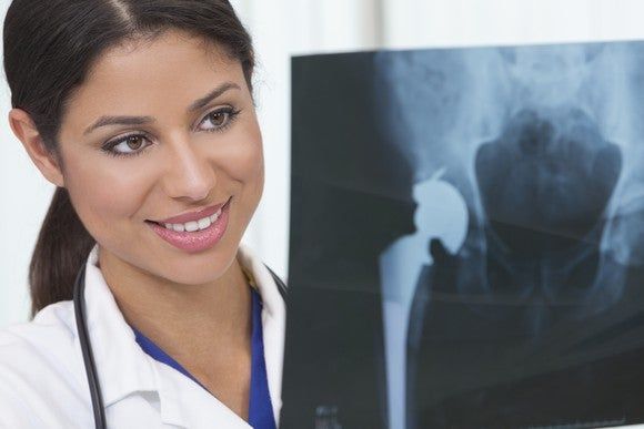Female Doctor Examining X Ray Of Patient Getty