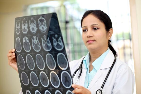 Female Doctor Examining Brain Xrays Cancer Getty