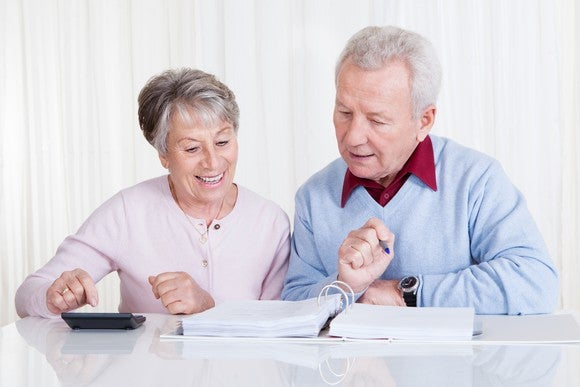 Senior Couple Discussing Finances Getty