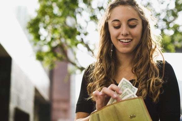 Woman With Moolah By Getty