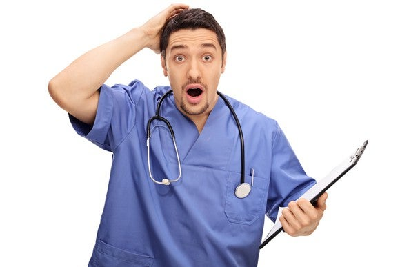 Surprised Doctor With Clipboard Sthethoscope Getty