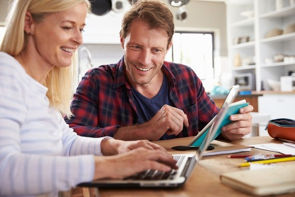 Husband And Wife Reviewing Investments