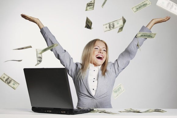 Woman Throwing Money Raining Money Getty