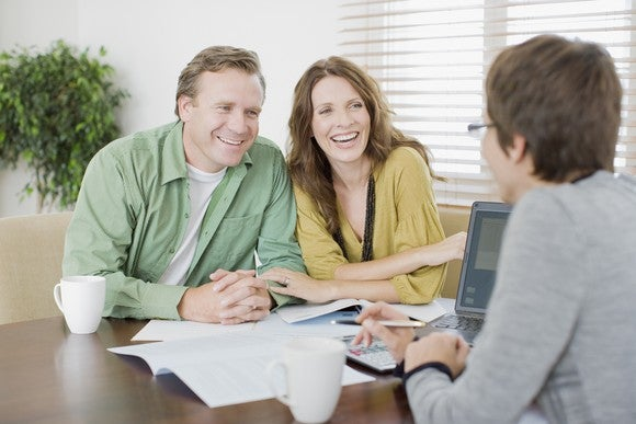 Younger Couple With Financial Advisor