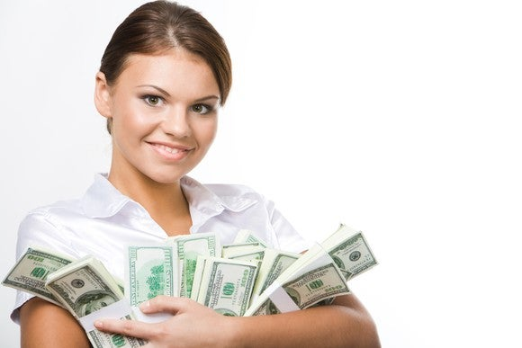 Young Woman Holding Stacks Of Money In Her Arms Getty