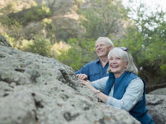 Older Couple Near A Boulder