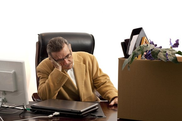 Older Worker Sad And Packing Up Desk