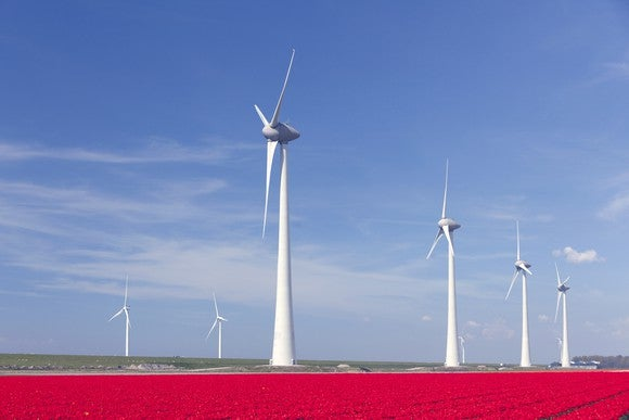 Wind Power Farm Red Tulip Field Blue Background Getty