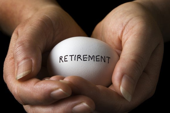 Nest Egg Retirement Held By Hands Getty