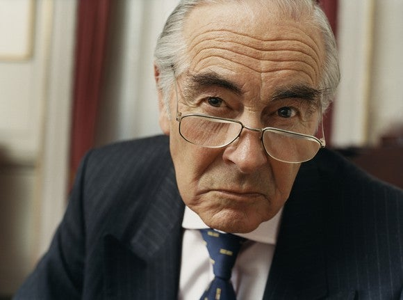 Senior In Suit Annoyed Portrait Getty