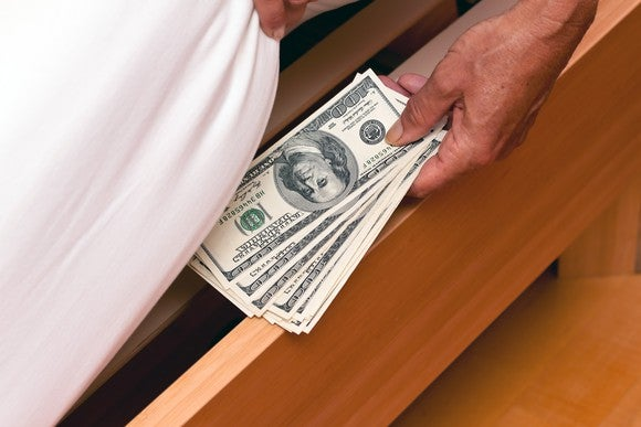 Put Money Under The Bed Cash Saving Getty