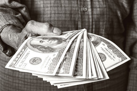 Senior Holding Cash Retirement Distribution Getty