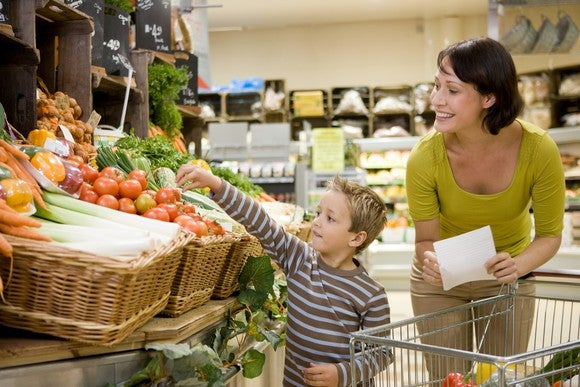 Grocery Supermarket Shopping Shopping List Mother Child Vegetables Cart Tomatoes Smiling Getty