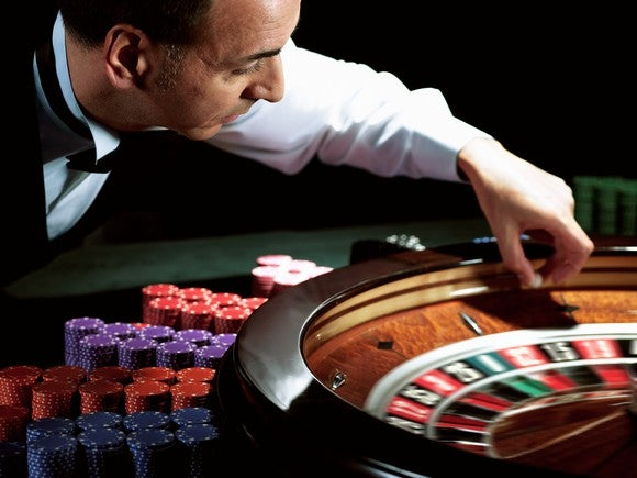 Casino Gambling Roulette Croupier Betting Chips Male Getty