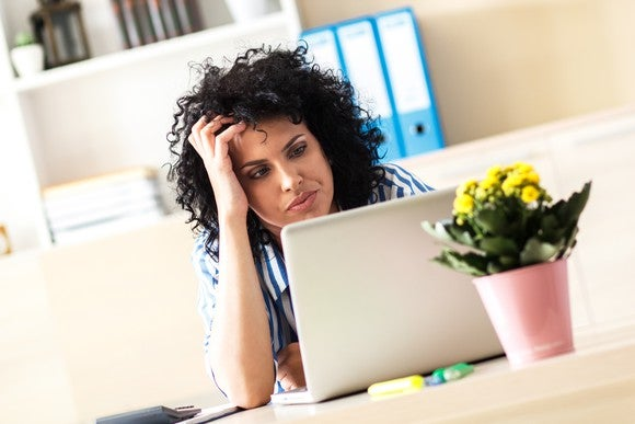 Frustrated Woman On Laptop Concerned Getty