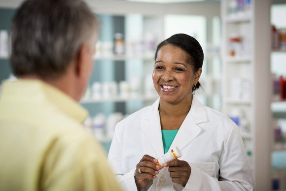 Pharmacist Dispensing Drugs Patient Cost Getty