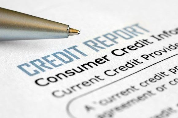 Credit Report With Pen Getty