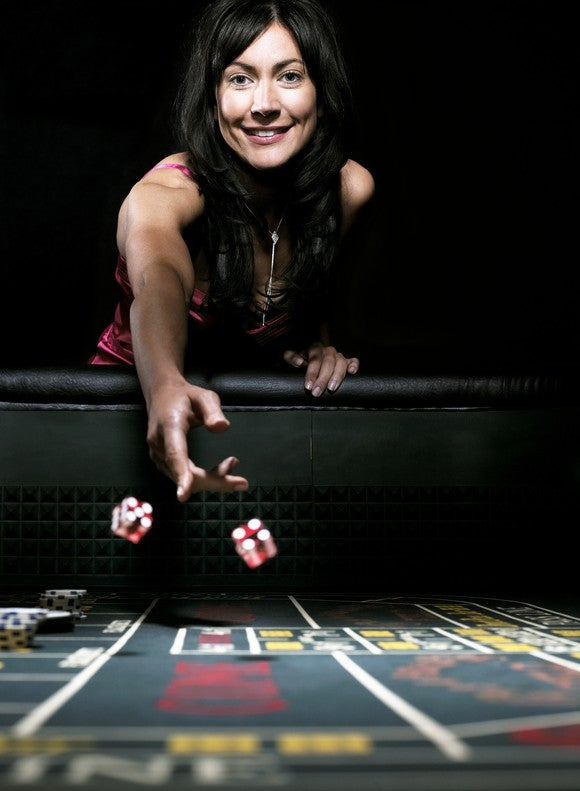 Dice Craps Gambling Woman Rolling Casino Getty