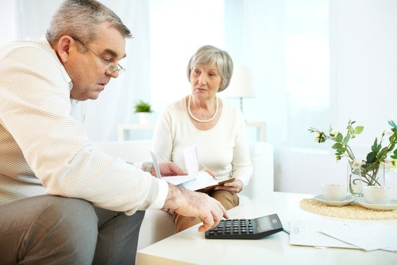 Retired Senior Couple Reviewing Finances Getty