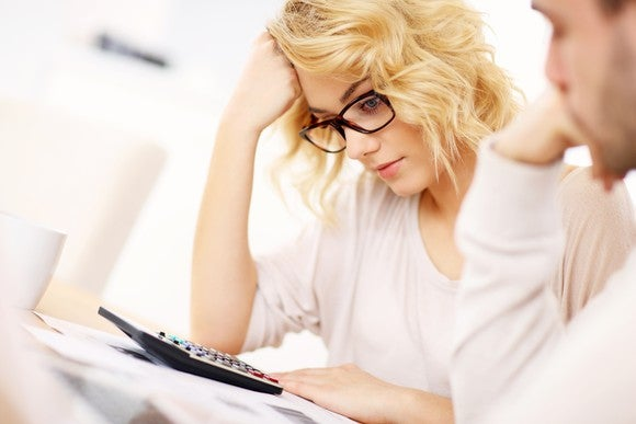 Preparing Taxes With Calculator Confused Girl Getty