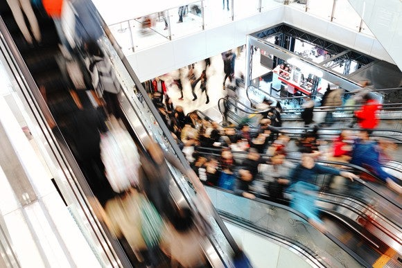 Shopping Christmas Thanksgiving Holiday Crowd Sales Retail Stores Escalator Mall Shopping Getty