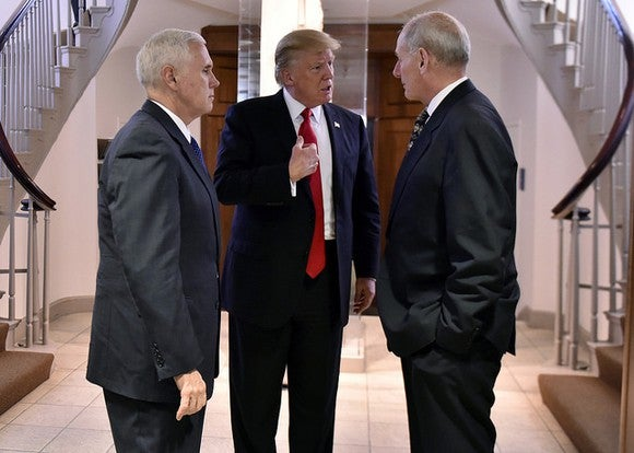 President Trump having a discussion with VP Mike Pence and Secretary of Homeland Security John Kelly.