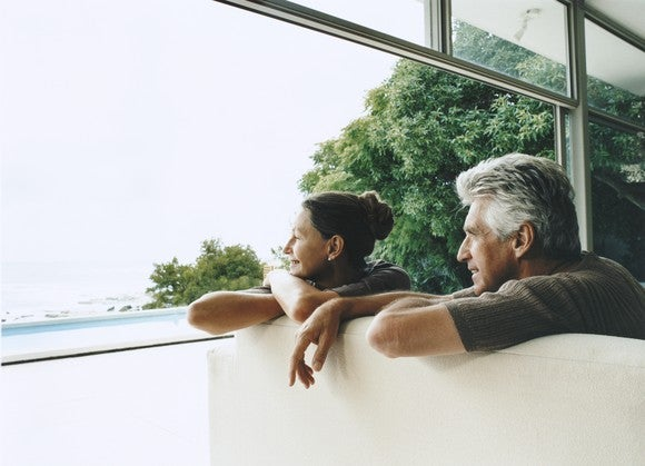 Senior Couple Looking Out Window Retirement Gettyimages Dv
