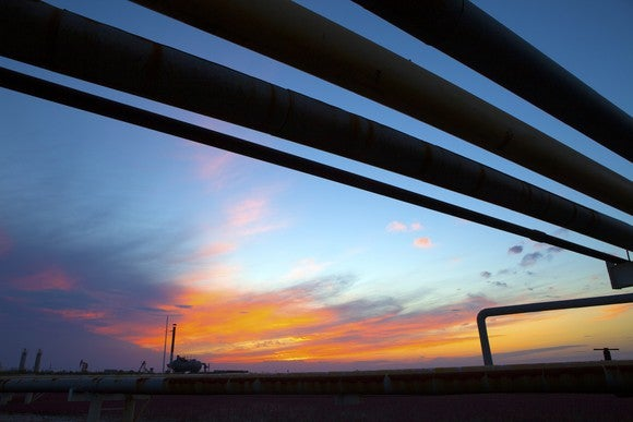 A trio of pipelines at sunset.