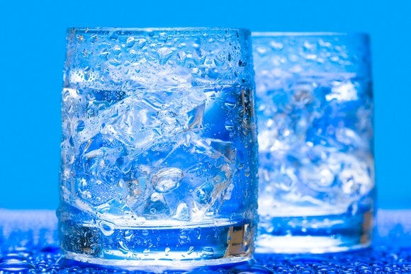 Water Two Water Glasses With Ice Bright Blue Background Getty