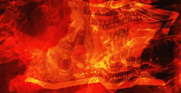 Burn Money Corporate Loss Obamacare Getty