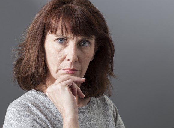Mature Woman Focused With Hand On Chin Getty