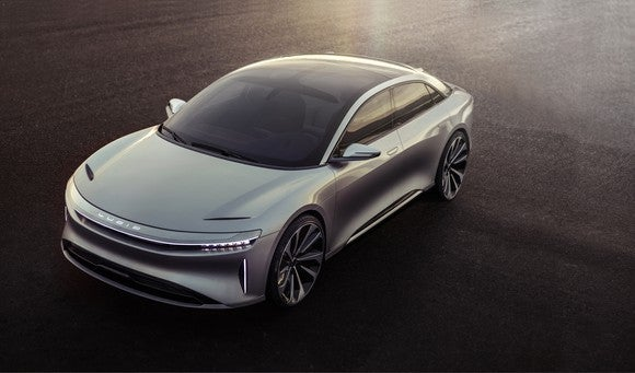 A silver Lucid Air sedan, front and side view.