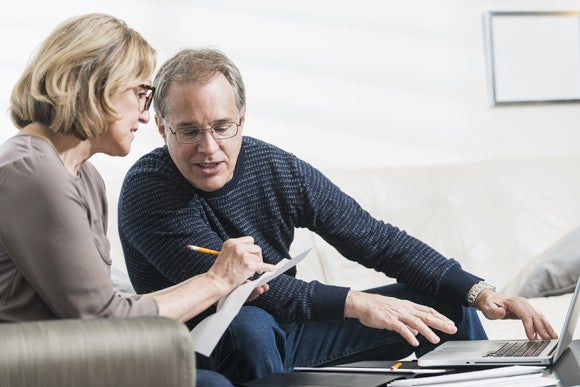 Older couples reviewing their financial plan