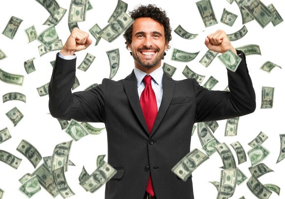 Man In Suit Money Falling Gettyimages