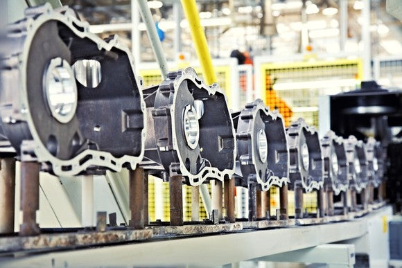 Engines being manufactured in a factory.